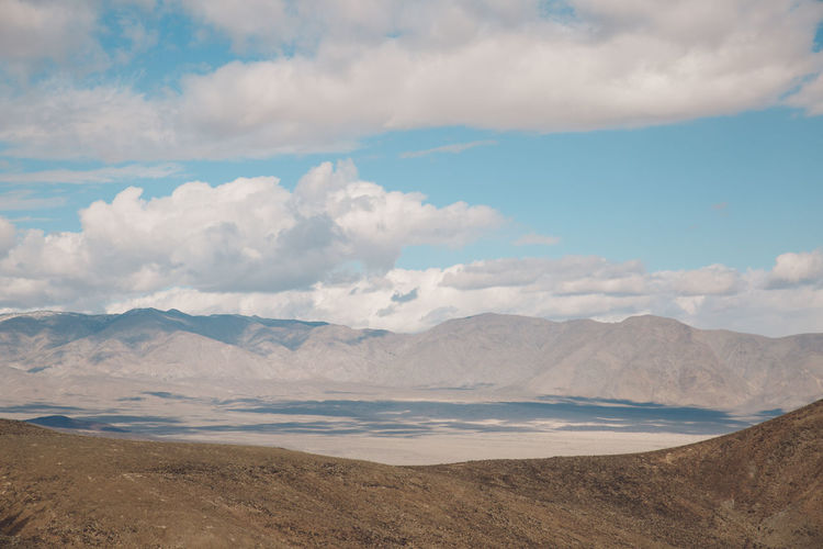 Arid Climate Arid Landscape Beauty In Nature Cloud - Sky Day Death Valley Death Valley National Park Desert Landscape Mountain Mountain Range Mountains Nature Nature No People Outdoors Physical Geography Road Roadtrip Salt Flat Sand Scenics Sky Tranquil Scene Tranquility