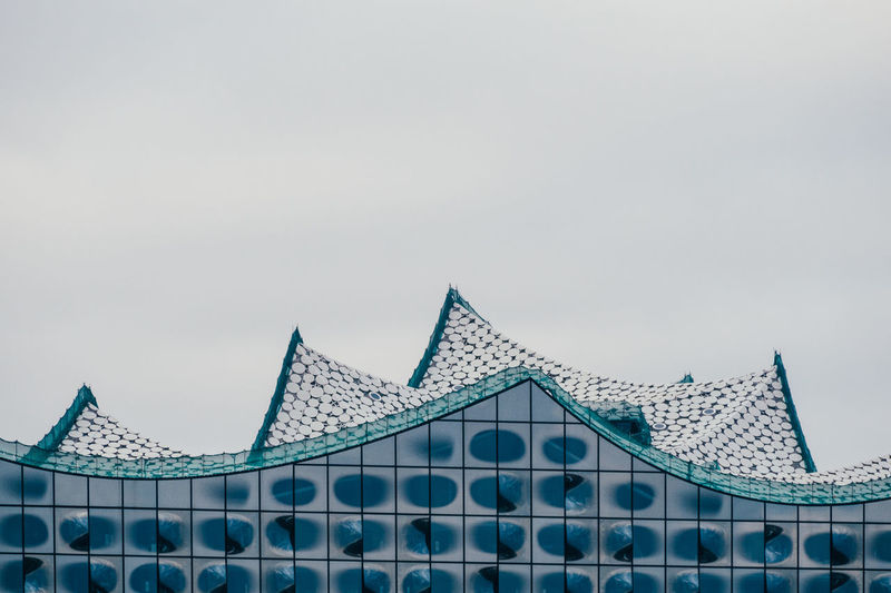 High section of elbe philharmonic hall against sky