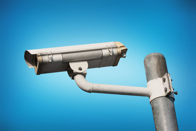 Big Brother - Orwellian Concept Binoculars Blue Blue Background Clear Sky Close-up Coin Operated Day Low Angle View Metal Nature No People Outdoors Protection Safety Security Security Camera Security System Silver Colored Sky Sunlight Surveillance Technology