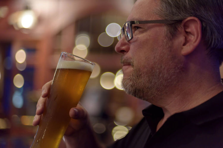 Man drinking beer from glass