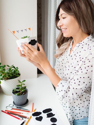 Young woman looking at camera at home
