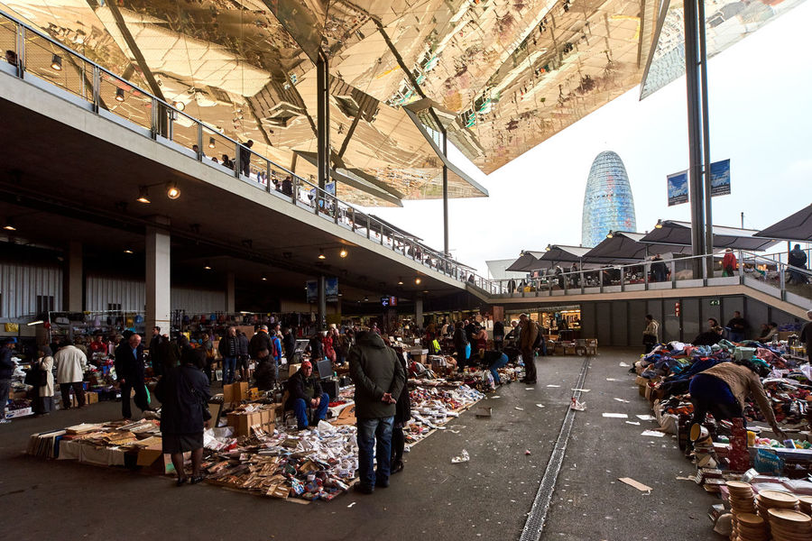 Barcelona, Spain - April 4, 2016: Inside of Mercat dels Encants. It is a Barcelona's largest and best known flea market. One of the oldest flea markets in Europe and Spain Adults Only Architecture Barcelona, Spain Bazaar Built Structure Buy And Sale Catalonia City Day Editorial  Europe Fleamarket Landmark Large Group Of People Marketplace Mercat Dels Encants De Barcelona Peoples Public Places Retail  Roof Secondhand Shopping Mall Sightseeing SPAIN Travel Destinations