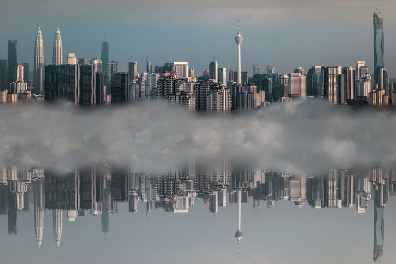 Panoramic view of city skyline against sky