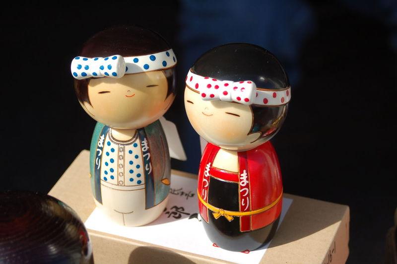 Close-up of kokeshi doll on box