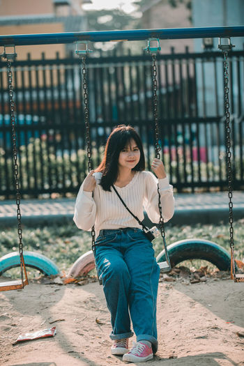 Young woman looking at playground
