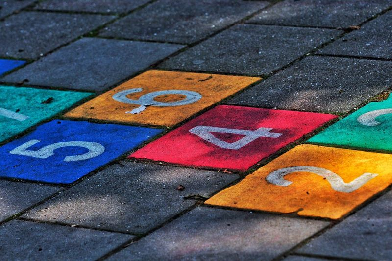 High angle view of colorful hopscotch numbers on street