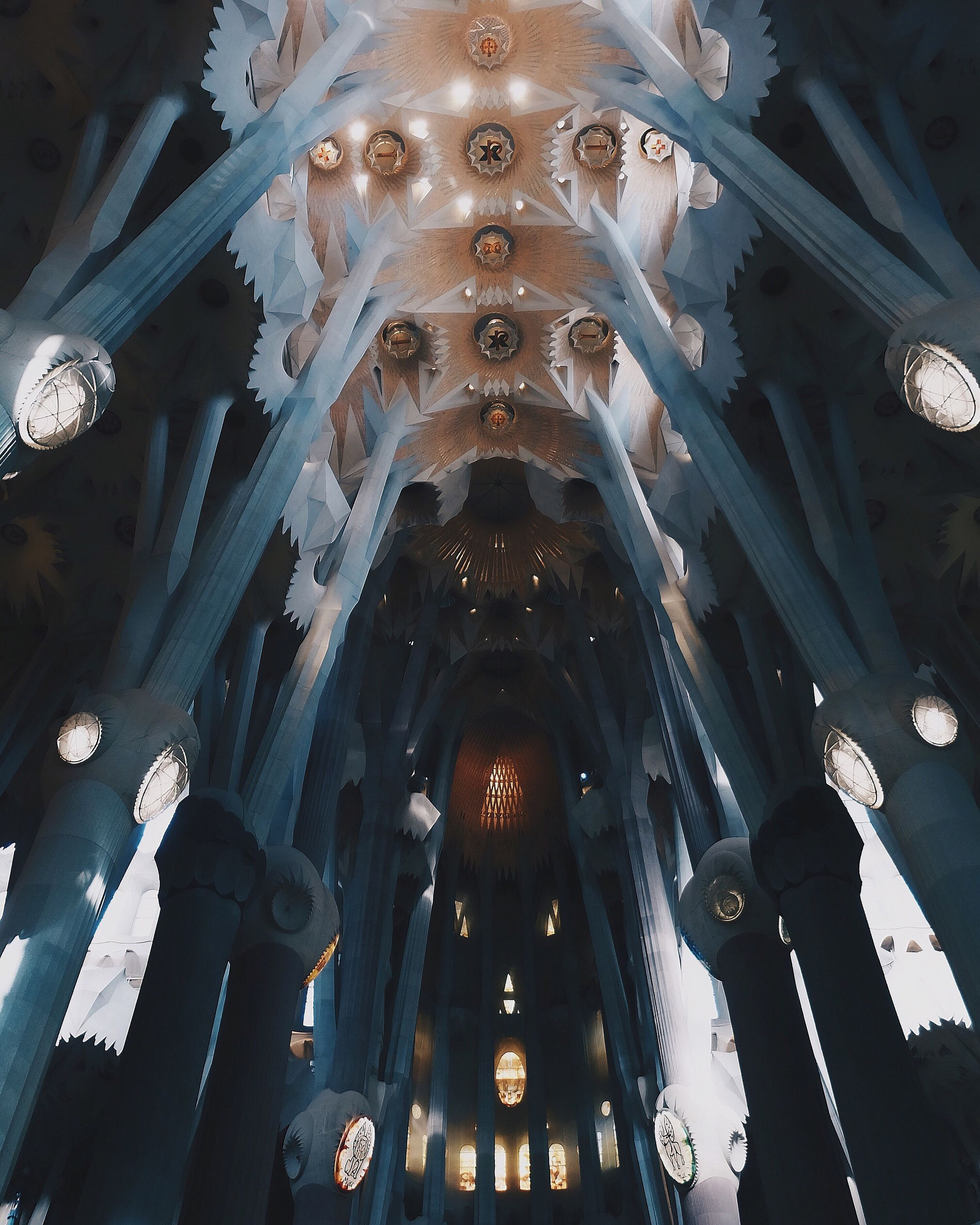 low angle view, ceiling, architecture, architectural feature, place of worship, religion, built structure, indoors, spirituality, no people, illuminated, travel destinations, day