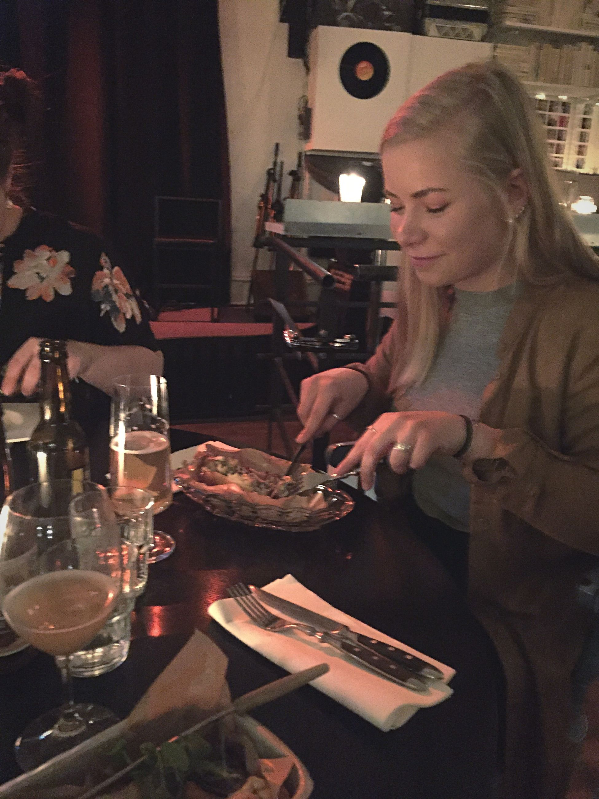 eating, indoors, candid, table, young women, dinner, adults only, adult, young adult, people, lifestyles, women, real people, domestic life, females, food, domestic room, men, one person, brunch, night, only men