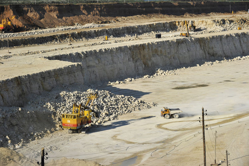 High Angle View Of Earth Mover Working At Quarry