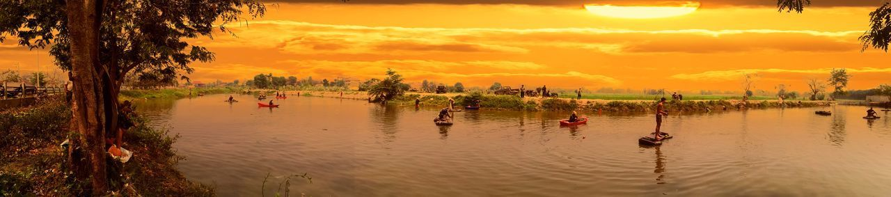Sunset Reflection Water Nature Sky Travel Tree Cloud - Sky Outdoors Lake Vacations Tranquility Beauty In Nature Landscape No People Day