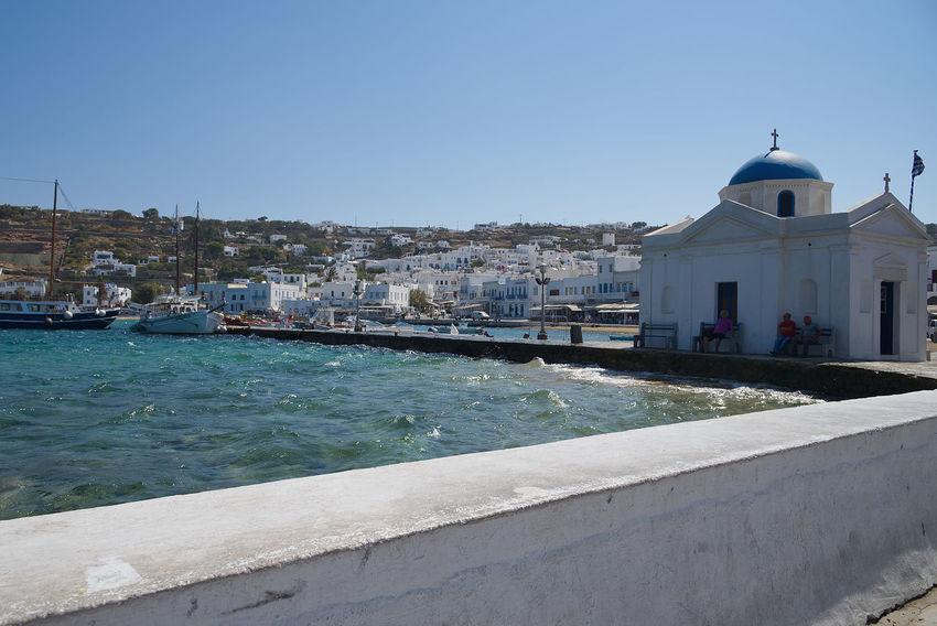 Chora village ( Beach and harbor ) - Mykonos Cyclades island - Aegean sea - Greece Aegean Chora Mikonos Pier Architecture Belief Building Building Exterior Built Structure Canal City Clear Sky Day Dome Greece Island Nature No People Outdoors Place Of Worship Religion Sky Spirituality Sunlight Water