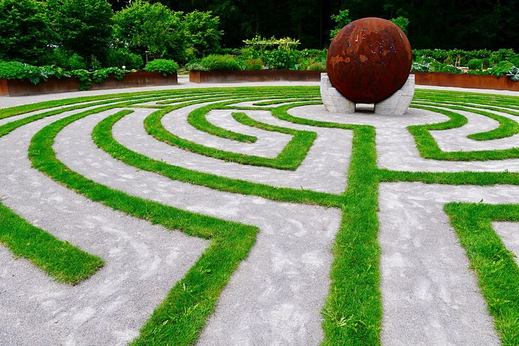 Direction Winding Path Path Of Life Labyrinth Holding Hands World Earth Hands Sculpture Sphere Plant Green Color Grass Maze Creativity Garden Shape Pattern Formal Garden Nature Geometric Shape Design No People Park - Man Made Space Footpath Hedge Growth Park Tree
