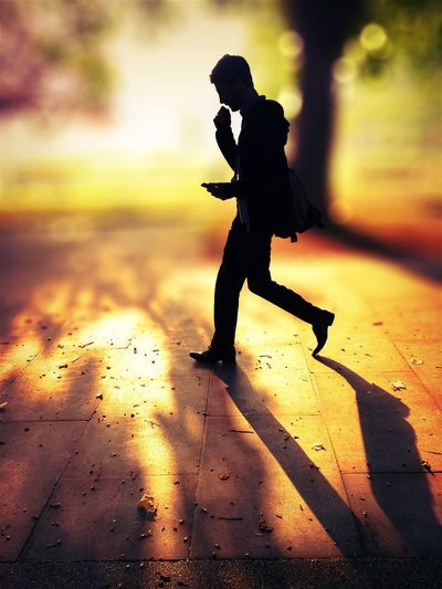Status update The Color Of Technology Lifestyles Leisure Activity Full Length Childhood Street Shadow Boys Sunset Side View Casual Clothing Focus On Foreground Outdoors Day Footpath Backlit