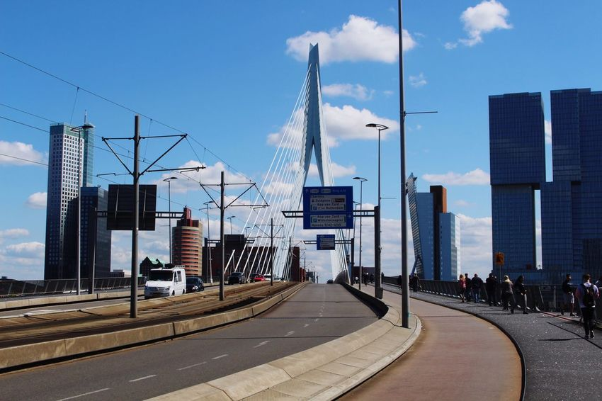 Bridge Holland Erasmus Rotterdam Bridge Architecture Built Structure Sky Building Exterior City Nature Day Sign Tall - High Transportation Road Cloud - Sky Street Building Office Building Exterior Tower Direction Outdoors Sunlight No People