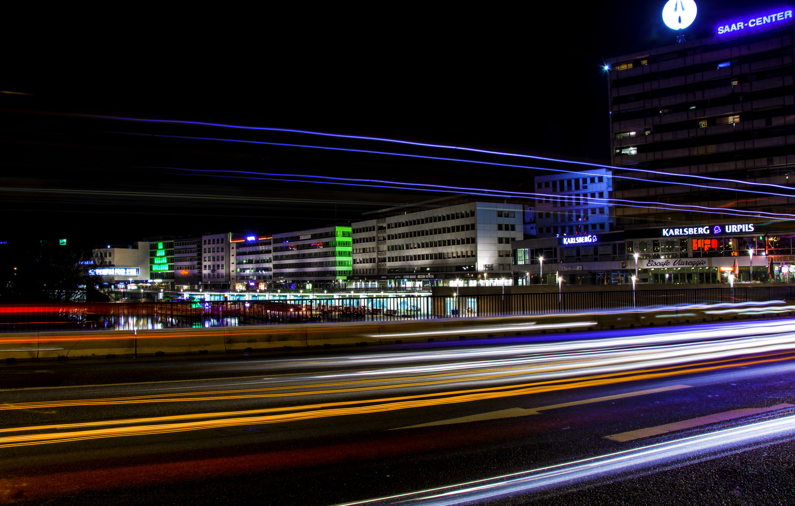 night, illuminated, transportation, light trail, speed, road, street light, long exposure, traffic, building exterior, street, city, architecture, built structure, car, motion, outdoors, no people, city life, connection