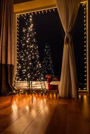 View of illuminated lighting equipment at home