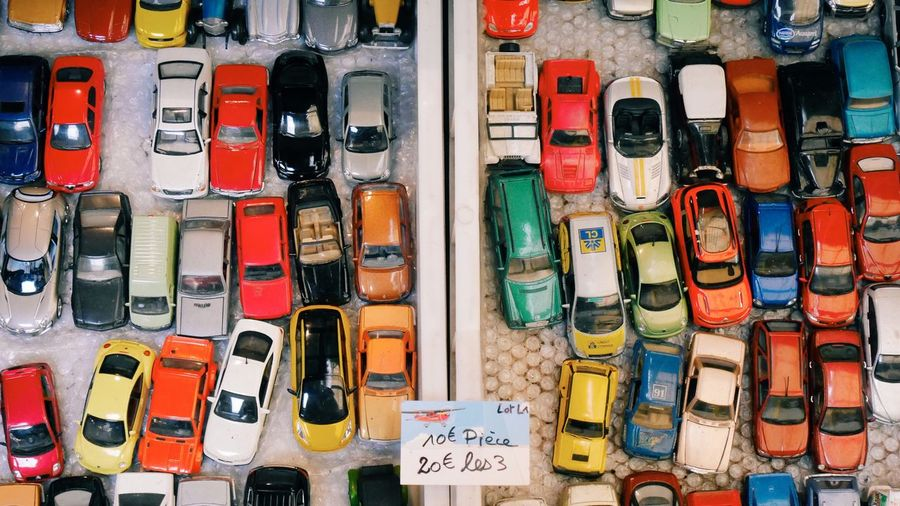 Full frame shot of colorful toy cars with label at store