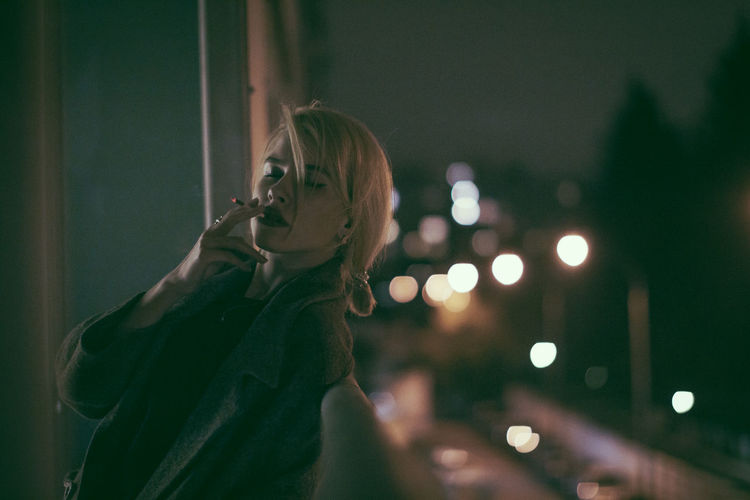 Woman smoking at night