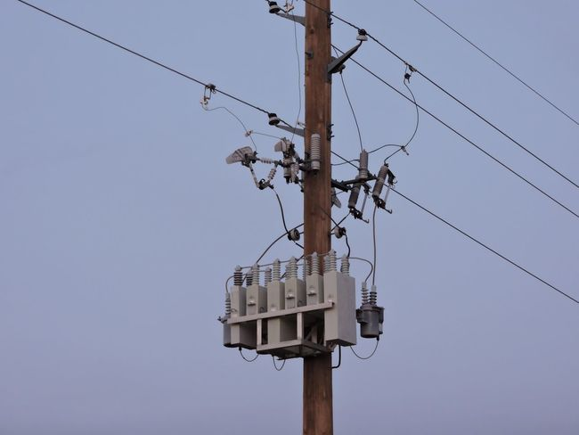 Box on light pole Connection Communication Outdoors Cable No People Telecommunications Equipment Antenna - Aerial Technology Clear Sky Day Electricity Pylon Telephone Line Sky