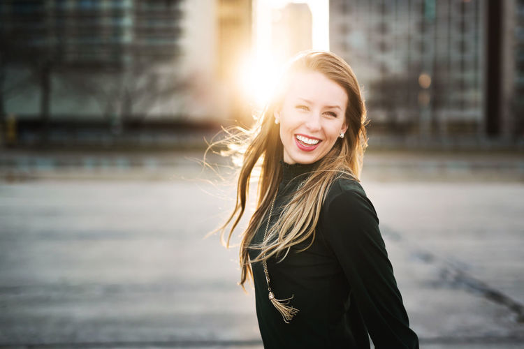 Chicago City Laughing Adult Beautiful Woman Buildings Cheerful Day Focus On Foreground Happiness Leisure Activity Lifestyles Long Hair Nature One Person One Young Woman Only Outdoors People Portrait Real People Smiling Sunflare Sunset Young Adult Young Women