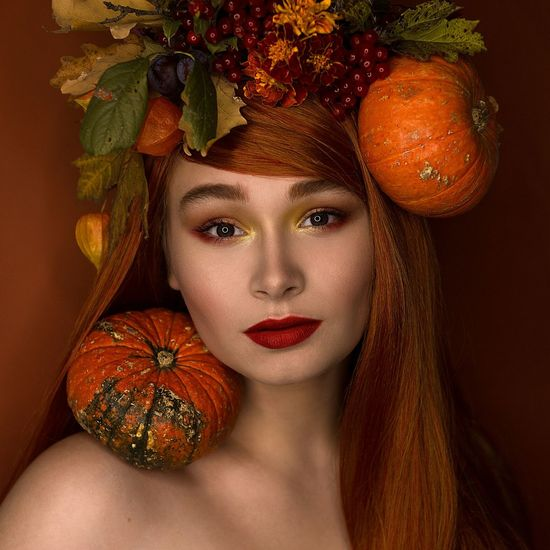 Portrait of young woman with decorative vegetables