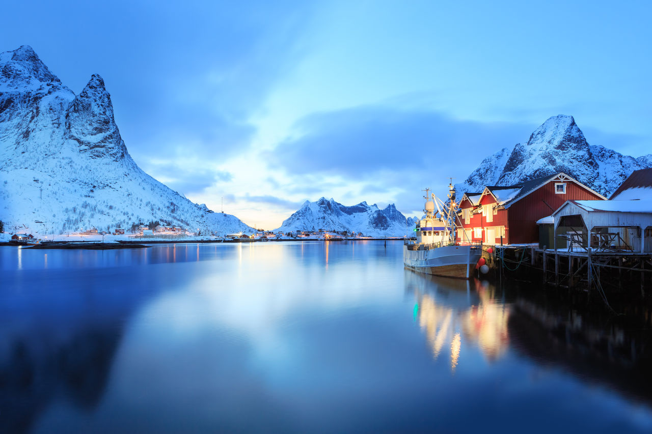 mountain, reflection, snow, water, lake, nature, mountain range, scenics, beauty in nature, cold temperature, winter, tranquil scene, tranquility, outdoors, blue, sky, no people, day, architecture, iceberg