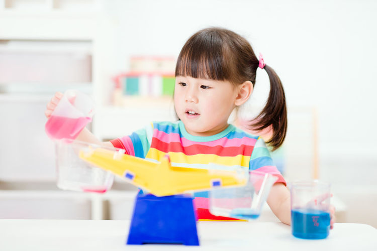 Young girl play balance toy for homeschooling