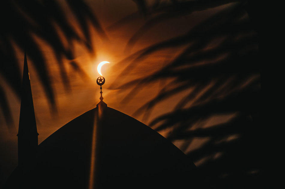 Arts Culture And Entertainment Atmosphere Copy Space Dark Flares Glowing Illuminated Light Low Angle View Masjid Masjid Sultan Salahuddin Abdul Aziz Shah Mosque Mystery Night Partial Solar Eclipse Silhouette Solar Eclipse Solar Eclipse 2016 Spirituality Q Landscapes With WhiteWall Telling Stories Differently My Favorite Photo The Photojournalist - 2016 EyeEm Awards