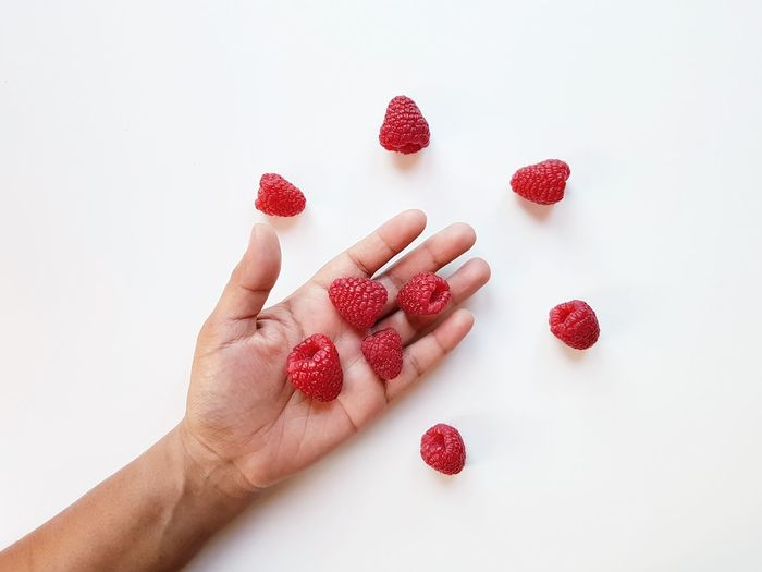 The Week on EyeEm Berry Fruit Studio Shot Fruit Human Lips Human Hand Holding Hands Delicious Red Healthy Eating Healthy Fruits Fruits ♡ Pictureoftheday Picoftheday Human Body Part Hand Body Part White Background Real People Holding Indoors  Finger Human Finger Raspberry Raspberries
