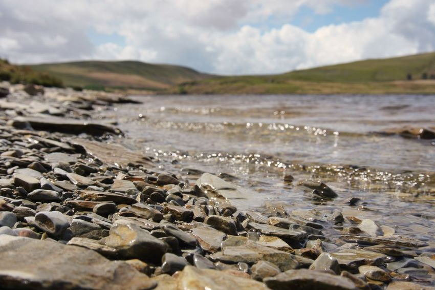 Waterside Of Lake Elan Valley, Wales Nature Beach Water No People Outdoors Day Sea Beauty In Nature Sky