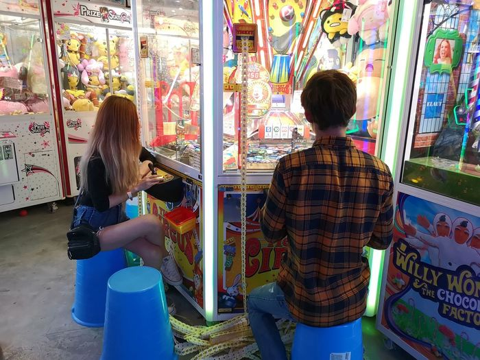Arcade Arcade Games Arcades Arcade Game Arcade Machine Entertainment Fun Addicted Addiction Multi Colored Rear View Standing Powder Paint Face Powder Graffiti Display For Sale Couple Shopaholic Friend Street Art