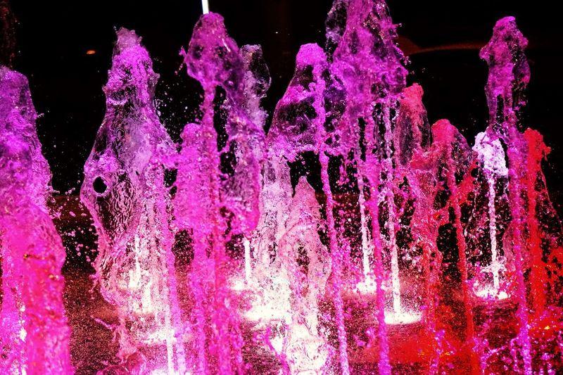Fountain Of Light Fountain Lights Fountain Fun Water No People Motion Splashing Nature Close-up Outdoors Studio Shot Night Black Background Illuminated Pink Color Pattern Drop Celebration