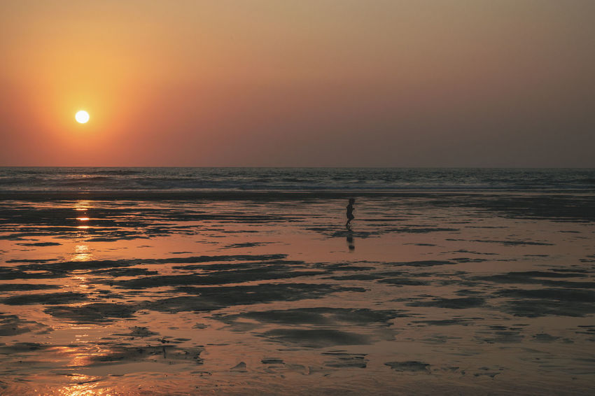 Running Beach Beauty In Nature Horizon Horizon Over Water Idyllic Land Nature No People Orange Color Outdoors Reflection Scenics - Nature Sea Sky Sun Sunlight Sunset Tranquil Scene Tranquility Water