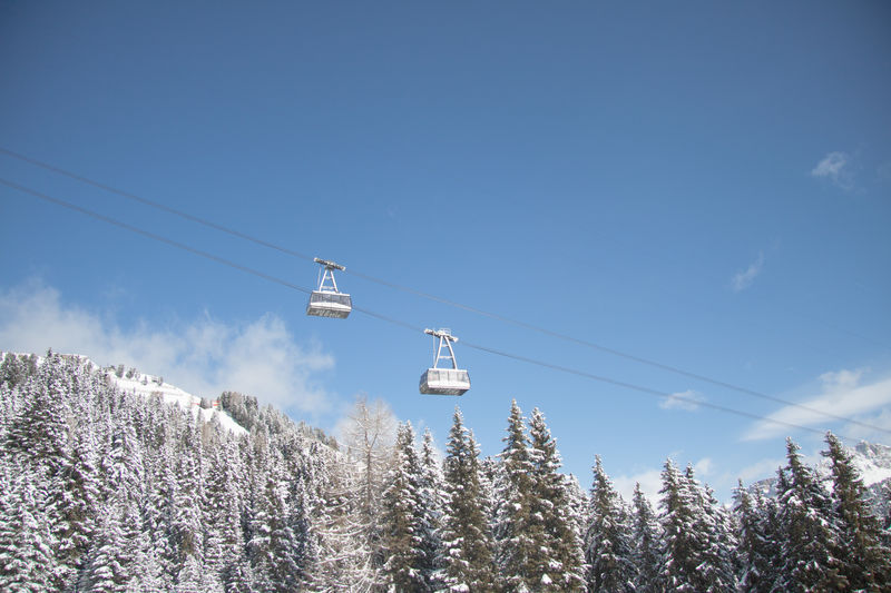 Over my head the blue sky and cable way getting to the top. Blue Sky Gröden Landscape Mountain Outdoor Sport Overhead Cable Car Ski Lift Snow Tranquil Scene Val Gardena