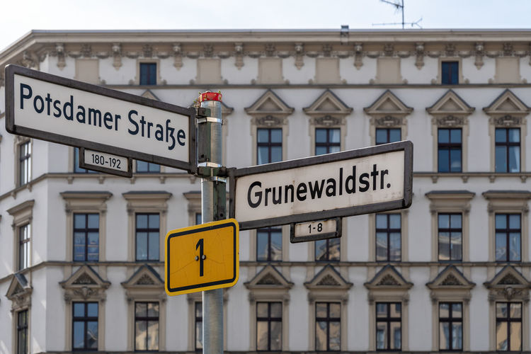 Copy Space Schöneberg Architecture Building Building Exterior Built Structure City Close-up Communication Day Focus On Foreground Grunewaldstrasse Guidance Information Information Sign No People Outdoors Potsdamer Strasse Road Road Sign Sign Street Sign Symbol Text Yellow