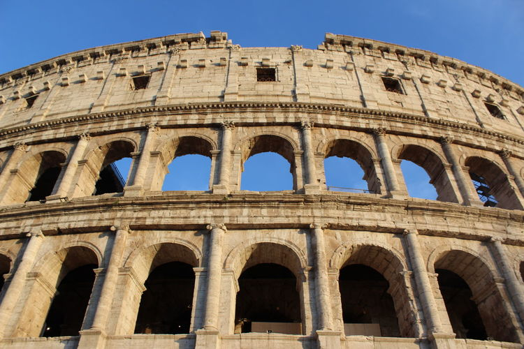 Low angle view of historical building against sky. colosseum, rome, italy