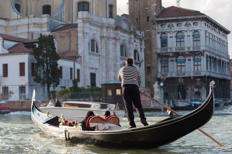 Venice Italy Venezia Travel Destinations Travel City Cityscape Architecture Built Structure Canal Water Waterfront Gondola - Traditional Boat Gondola Transportation Gondolier Outdoors Leisure Activity Oar Real People Grand Canal - Venice Grand Canal Vacations Romantic Sky City Break