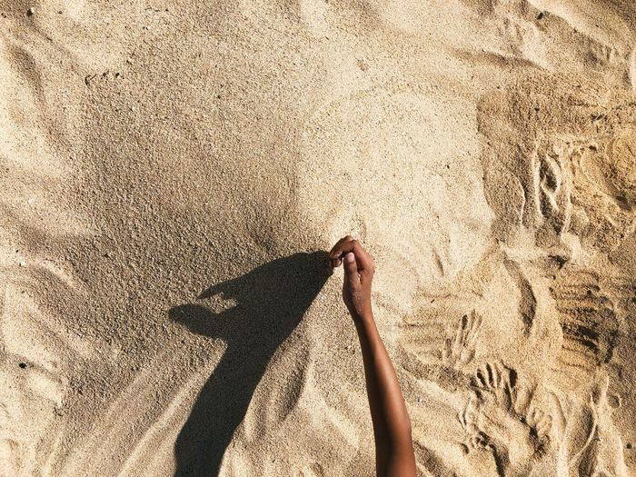 Shadow Of Hand On Sand