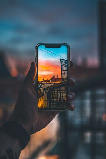 iPhone X sunset Sunset EyeEm Selects Wireless Technology Technology Human Hand Photography Themes Human Body Part Hand Photographing Portable Information Device Holding Screen Activity Smart Phone Sky Communication Mobile Phone One Person Photo Messaging Cloud - Sky Device Screen Close-up