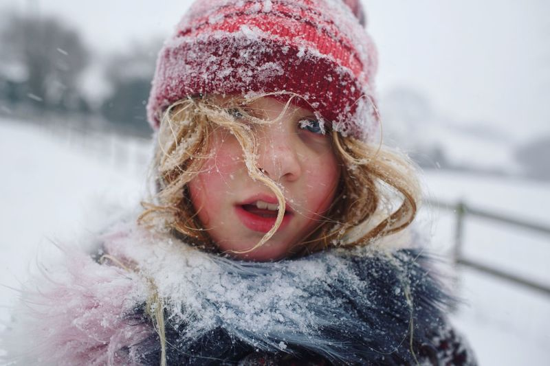 Blizzard People Snow Covered Childhood Memories Winter Snowing Childhood Snowflake Portrait Outdoors Real People Headshot Go Higher Cold Temperature Warm Clothing Child Hat Extreme Weather