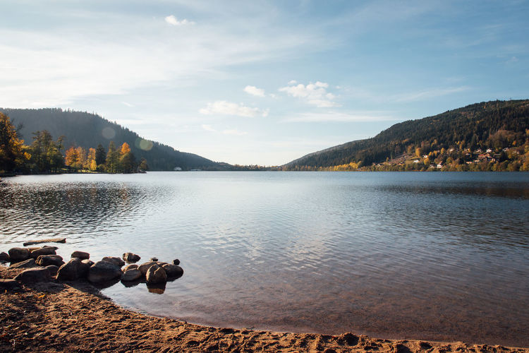 Scenic view of lake against sky. scenic view of gerardmer's lake.