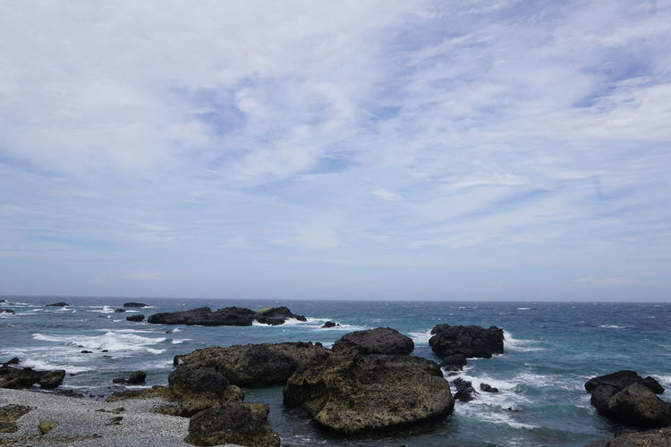 Beauty In Nature Calm Cloud Cloud - Sky Cloudy Coastline Day Horizon Over Water Idyllic Nature No People Ocean Outdoors Remote Rock Rock - Object Rock Formation Scenics Sea Seascape Shore Sky Tranquil Scene Tranquility Water