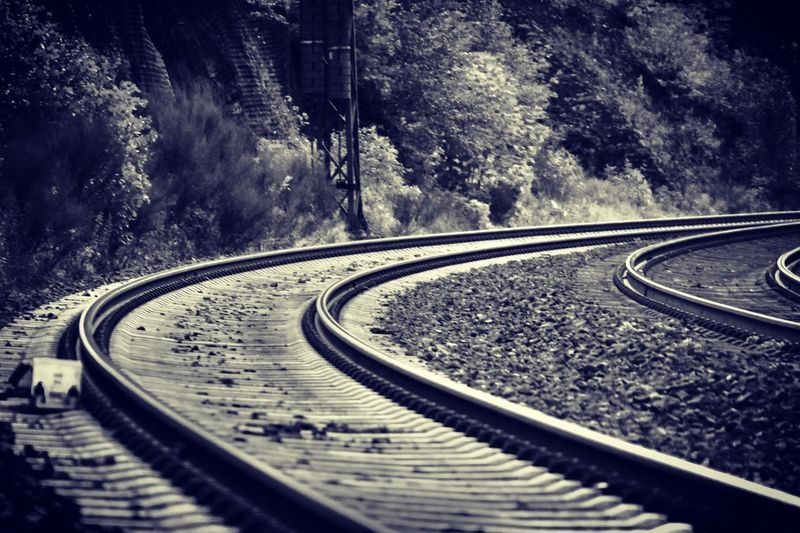 Railroad tracks by road in city