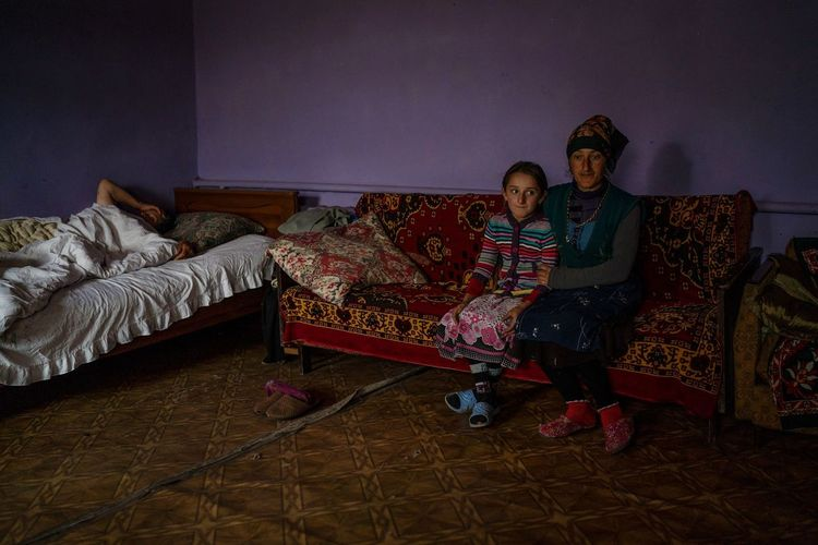 """From the ongoing project """"The lost identity"""". An untold story of a tiny village in the country of Georgia wherethree ethnic groups live there and cannot stand each other: Russian Doukhobors, Muslim Georgians, and Christian Armenians. Documentary Series Reportage Village Society Portrait Woman Daughter Girl Kid Home House Photography Georgia Armenia Russia Identity Social Issues Human Community Civilization Bedroom Full Length Sitting Living Room Bed Home Interior Domestic Life Women Couch"""