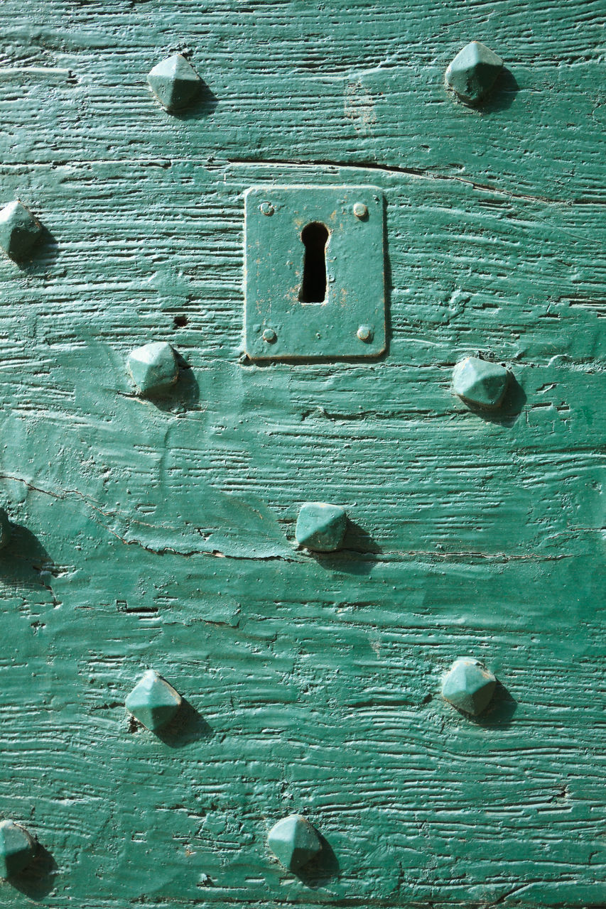 full frame, backgrounds, textured, door, old, weathered, close-up, rough, metal, wood - material, day, outdoors, green color, pattern, paint, nut - fastener, no people, hinge, built structure, architecture