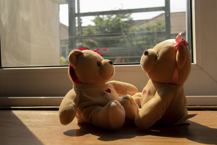 Close-up of stuffed toy on window sill