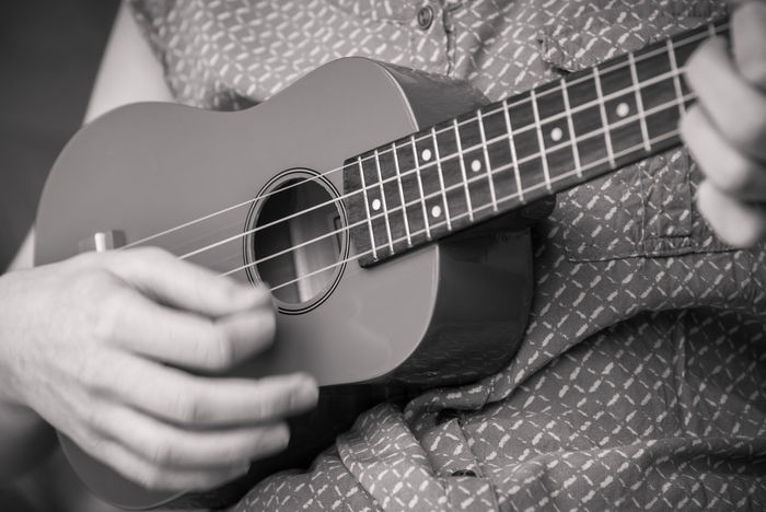 Close-up of girl's hand strumming a soprano ukulele monochrome image Acoustic Hands Woman Black And White Close-up Close—up Female Fingers Fretboard Girl Monochrome Music Music Education Music Lesson Music Student Musical Instrument Musician Performance person Playing Soprano Ukulele Soprano Ukulele Stringed Instrument Strumming Ukulele