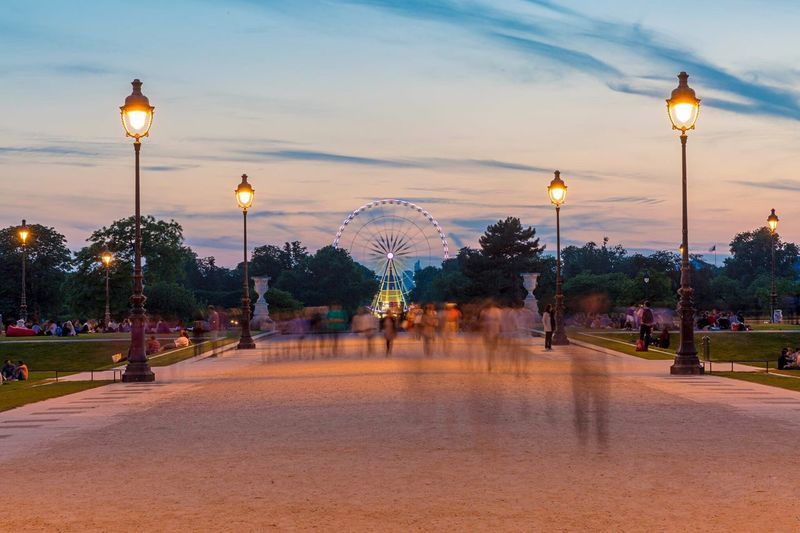 Blurred Motion Of People On Footpath At Jardin Des Tuileries During Sunset