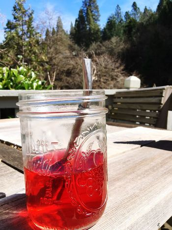 Cold brew tea on sunny day Drink Food And Drink Drinking Glass Freshness Refreshment Focus On Foreground Table Healthy Eating Cold Temperature No People Cold Drink Wood - Material Drinking Straw Water Close-up Day Outdoors Nature Sky