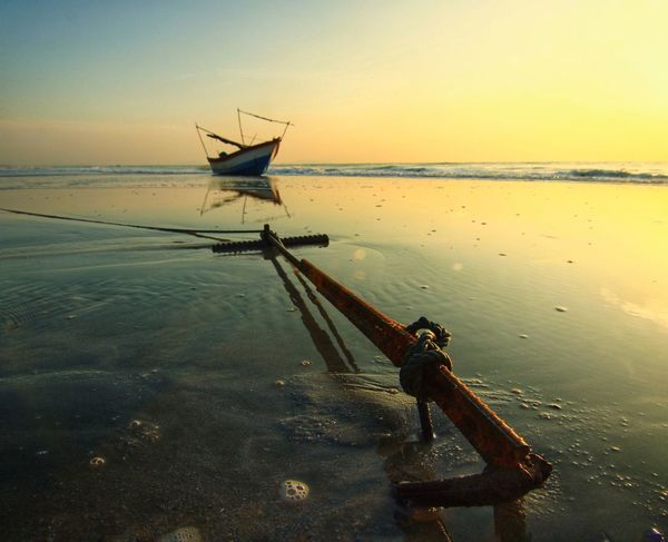 Anchor and boat Salt - Mineral Sunset Fishing Equipment Fisherman Shining Sun Sunrise Evening Fishing